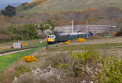 A down train emerges from the under bridge on Corfe Common at Townsend, 33108 leads 2S05 1045 from Norden to Swanage.