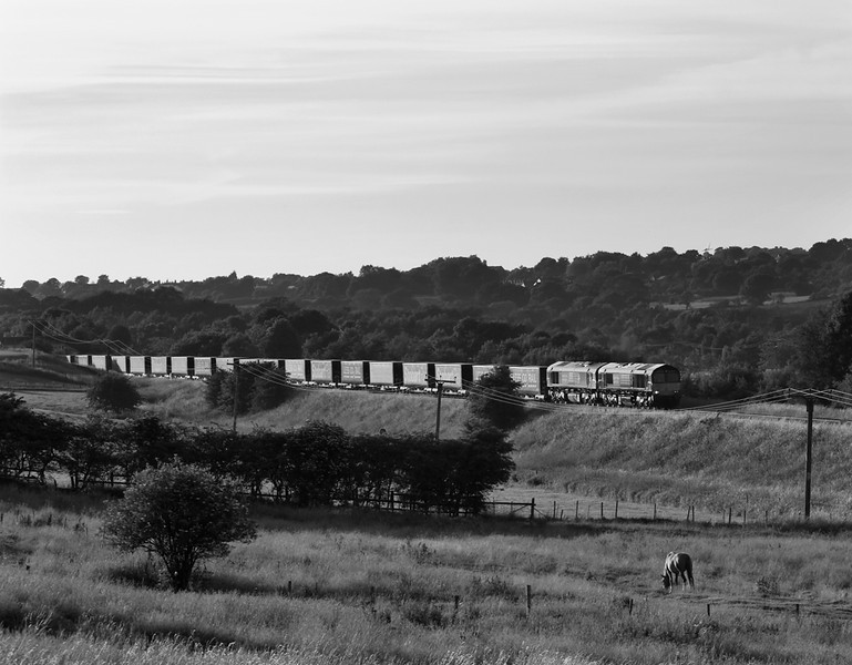 "66430 and 66429 head 6M48 Mossend Daventry ""Tesco express"" past Blackrod in the evening of 14 July 2013"