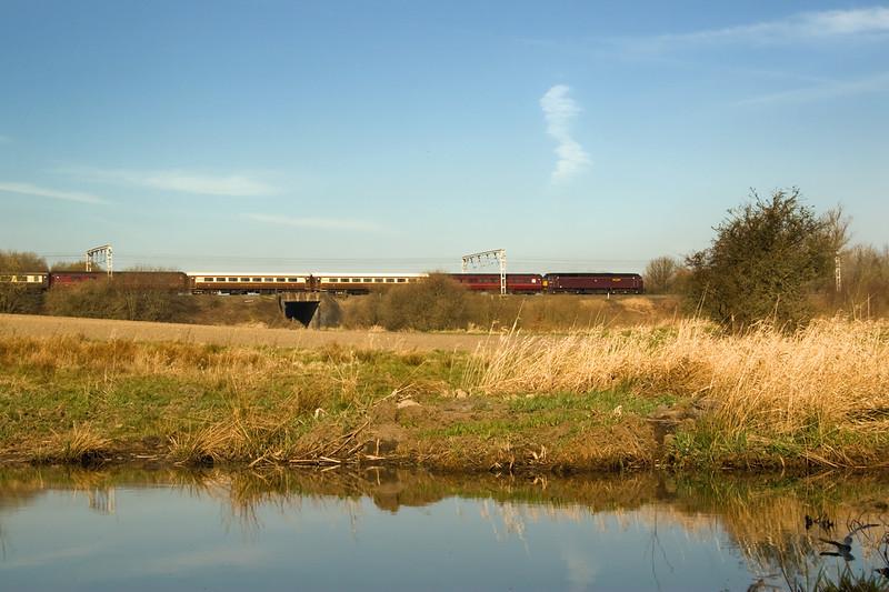 West Coast Rail 57 57601 is leading Statemsan Rail's Holyhead- Carlisle excursion ( 1S67) at Bamfurlong 20 April 2013