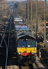 66430 threads through the knitting at Balshaw Lane Jct on the WCML north of Wigan with 4M30 Coatbridge -,Daventry 13 April 2013