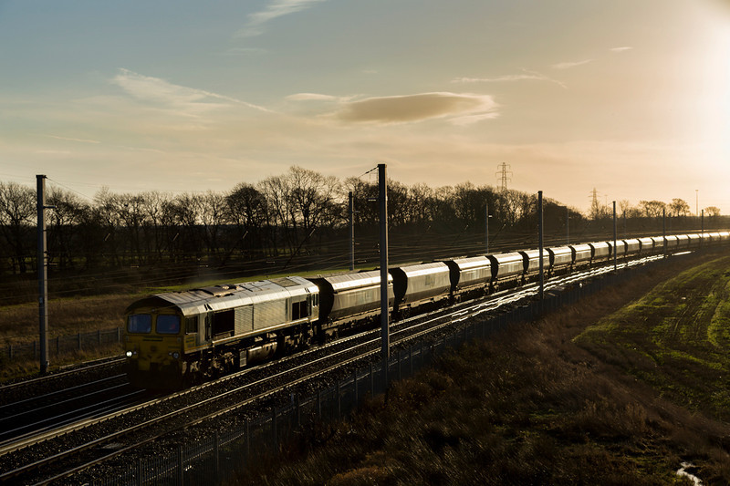 4C20 , today running from Crewe to Carlisle, heads out of the sun behind 66545 - 28/12/13