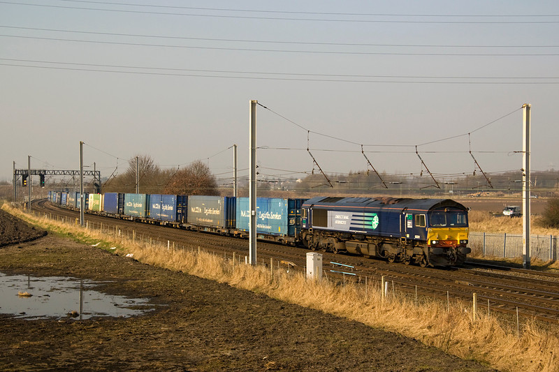 4M44 heads past Winwick with 66301 at the front - 5 March 2013