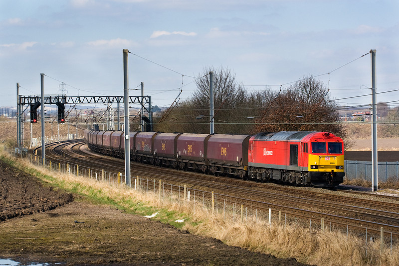 60092 dodging the shadows.  6F74 Liverpool Bulk, terminal to Fiddlers Ferry 29  March, 2013