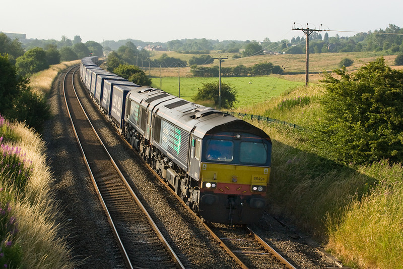 66424 and 66429 are hauling 4S43 Daventry Mossend past Blackrod 20 July 2013