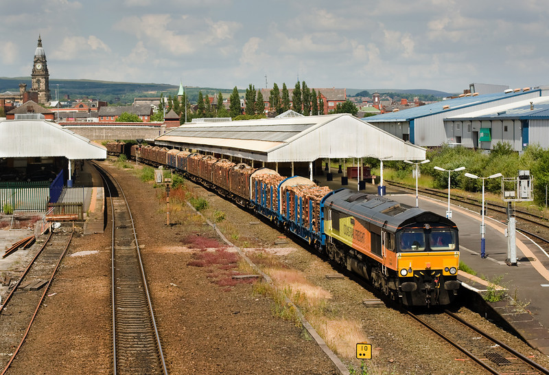 19 July and it's back to the architectural gem of Bolton.  - When will someone clear the weeds?  66849 is on 6J37 Carlisle-Chirk loaded logs.