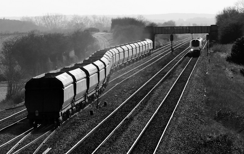 66953 takes a Killoch- Ferrybridge Coal train south past Colton Junction, while a class 220 races North on the 08.29 Penzance to Edinburgh on 6 April 2013