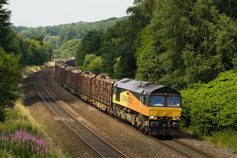 The class 56s have finished working the logs for the time being at least.  66849 passes Overdale on the outskirts of Bolton with 6J37 on 18 july 2013