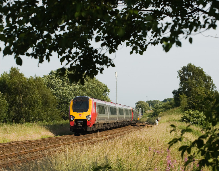 A pair of class 221 Voyagers ( 1M59 17.42 Preston-Birmingham ) passing the site of Blackrod box, during the weeklong  engineering blockade of the WCML 14 July 2013