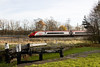 The St Helens Canal ran parallel to the WCML round Winwick.   This old lock had been semi restored , but is now falling into further disrepair.  before the palisade fencing went up some interesting shots could be had.   here a Pendolino is on a Glasgow- Euston service.  30 November 2013
