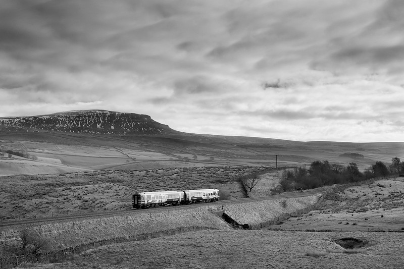 a class 156 heads south along the Settle-Carlisle line at Selside - 2 March 2013