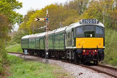 Class 25/1 D5185 crossed the class 33/2 at Harmans Cross and now comes by the distant signal dropping down grade with 2N09 1215 Norden to Swanage.