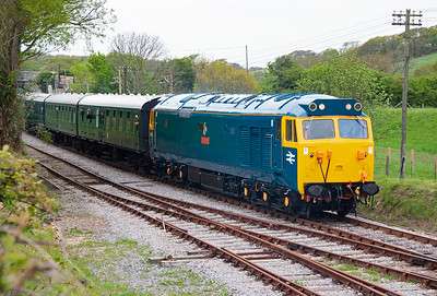 "Another returnee is class 50 type 4 50035 ""Ark Royal"" looking stunning in a spanking new coat of BR blue livery and full yellow cab. It passes through Herston with 1N01 1020 Norden to Swanage running about 30 minutes late due to the Hymek failing."