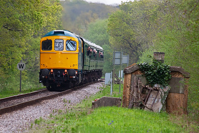 "Coming through the Wilderness in fine style is ""slim Jim"" 33201 with four mkI coaches and a Bulleid coach on the drawbar. The type 3 will be working a fair bit up the 1 in 76 grade with 2N12 1215 Swanage to Norden."