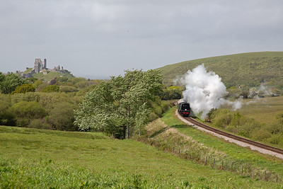 """We move to Afflington to wait for the convoy and time it so we catch the service train too.  BoB class pacific 34072 """"257 Squadron"""" climbs over Corfe Common and puts out a fine exhaust."""