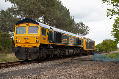The pair pass by running as 0Z59 1427 Eastleigh to Swanage.  In 1997 59003 was exported to Germany to haul stone trains and was operated by Yeoman/Deutsche Bahn.  In August 2014 it was bought by GBRf and repatriated in October 2014.
