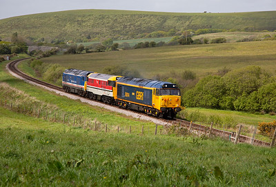 """The colourful combination climb the 1 in towards Afflington bridge.  There should have been a fourth loco in this convoy, class 44 Peak D4 """"Great Gable"""".  But it didn't leave Butterley due to unresolved engine issues, so it has missed the gala again!!"""