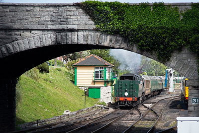 The next service train to Norden gets away with 34072 running tender first out of Swanage which is unusual.  Normally tender locos run chimney first out of Swanage because it is easier to get the tender under the water crane.