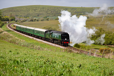 In lovely afternoon spring sunshine the westerly wind takes the exhaust away from the loco as the three cylinder pacific handles the five coach train with ease.