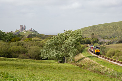 With the steam working clear of the Corfe to Harmans section, the convoy can get away.  With Corfe Castle in the background, the locos approach Afflington.