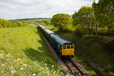 """The BR blue """"rat"""" is working 2N18 1440 from Swanage to Norden and comes through the cutting at Afflington."""
