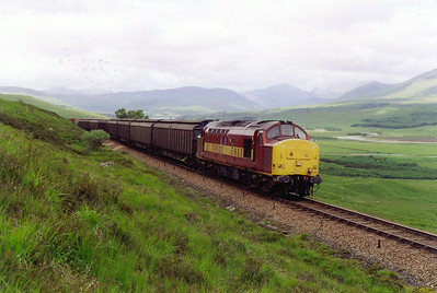 37419 could be heard a good distance away growling against the 1 in 66 pull towards Crannach Forest deep on Rannoch Moor. The train is 6Y45, 0636 Mossend to Fort William Enterprise, made up of cargo wagons and empty OTA timber wagons.