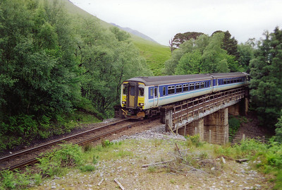 Deep in Crannach Forest 156492 and 156453 rattle over Barravourich Viaduct which spans a deep gully cut by Allt na Crannaich. Their train is 1Y41 0812 Glasgow Queen Street to Mallaig. All trains reverse at Fort William.
