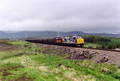 To the south of Rannoch, near milepost 62 1/2, 37423 and 37419 slug their heavy train of 9 ferry wagons loaded with paper up the 1 in 60 gradient on Rannoch Moor. The working is 7D60 1430 Fort William to Mossend Enterprise.  The next stop for me was Rannoch station and the train back to Bridge of Orchy and the drive home.