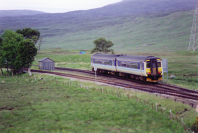 A down train from Glasgow Queen Street, 1812 off, runs through the loop. 156485 has split from the Oban portion to form 1Y47 2015 to Mallaig arriving at 2330. My green tent can be seen in front of the unit.