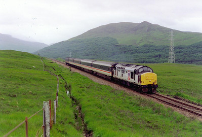 To the north of Bridge of Orchy, 37409 powers 1Y11 0505 Edinburgh to Fort William portion of the Euston to Inverness/Aberdeen/Fort William sleeper.