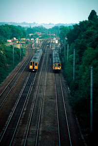 Two 312 and two 313 units passing at Knebworth 11/6/84