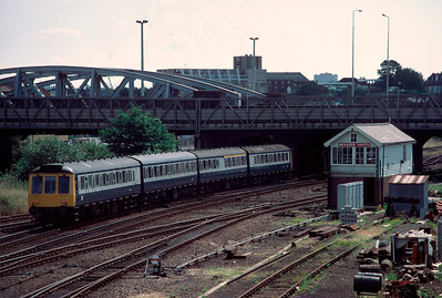 Class 115 DMU  with 09.12 Biscester  Marylebone passing Neasden 7/7/85