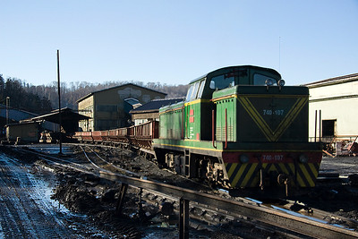 On the high level narrow gauge line 740-107 is pulling a train of coal hoppers through the discharge point