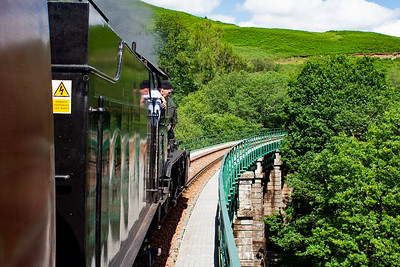 Onwards to Crianlarich and the railway passes over Glen Falloch viaduct and John Cameron looks down from the footplate on the fireman's side.