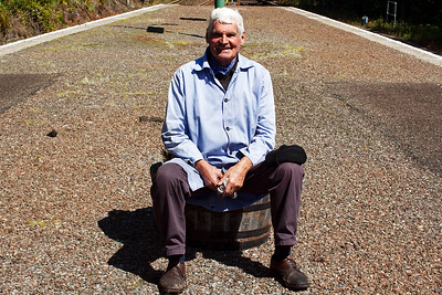 During a brief stop to pass a service train, John Cameron sits on a flower tub enjoying the sunshine and poses for a picture.