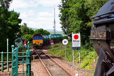 Bridge of Orchy station and a stop for the radio token and to cross the Fort William to Mossend empty oil tanks with 66108 fronting the rake of 8 TTA tanks.