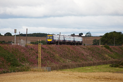 170407 comes over the tall embankment with a Fife Circle service 2G08 1038 from  Glenrothes with Thornton to Edinburgh.