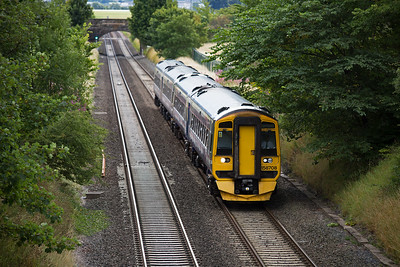 Approaching from the south is sprinter pairing 158807 and 158727 employed on 1H11 1036 Edinburgh to Inverness.