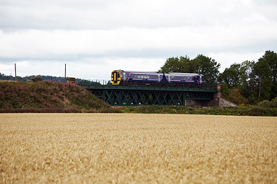 An unknown class 158 sprinter passes over the viaduct carrying the railway over the River Almond.  The working is 2K50 1053 Glenrothes with Thornton to Edinburgh.