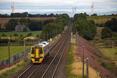 Heading north is 158871 rostered to the diagram that includes 2G65 1048 Edinburgh to Glenrothes with Thornton Fife Circle Outer.  In the distance is the south tower of the Forth Road Bridge and two of the three towers of the new Queensferry Crossing.