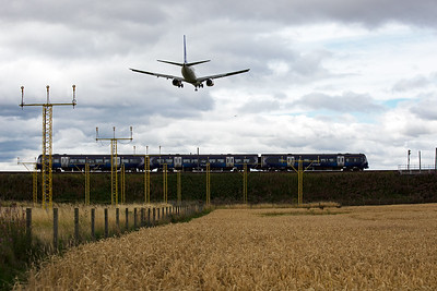 This is NOT a composite image and I finally got the shot I really wanted.  170432 passes by with 1A30 1130 Edinburgh to Aberdeen train, while Boeing 737-783 aircraft LN-RPK operated by SAS airline is on short finals to land with Flight SK4601 from Oslo to Edinburgh.  RESULT!!