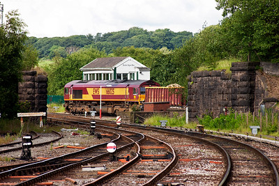 The train comes off the northern section of the former Buxton and High Peak Joint Railway and runs into Buxton's Up Relief Sidings where it will run round its train. The bridge abutments carried rails from the above line into the sidings on the west side of the main line which is now houses on Hogshaw Drive.