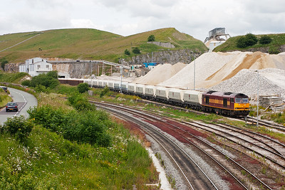 60047 propels its lengthy train of empty hoppers into the sidings to be reloaded with more stone.