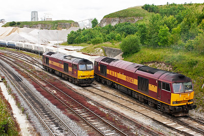 60047 passes 60021 as it backs its rake of wagons into the loading sidings at Peak Forest Quarry.