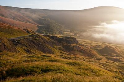 Looking to the north west from near Mam Tor and to the western end of the Hope Valley. The remains of the A625 road is in the middle ground and early morning mist is creeping into the right of shot.