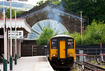 The driver of 150271 opens up his charge to depart the Spa town with 2H01 1706 to Manchester Piccadilly. The former LNWR station once boasted an overall roof which the far end fan tail windowed wall was part of it. The neighbouring and now demolished Midland Railway station was identical in appearance. Now it all appears very down at heel.