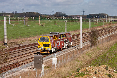 On Track Plant deserves to be recorded just as much as any other type of train. Plasser and Theurer 07-16 Universal Tamper/Liner trundles south on a quiet path.