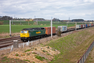 A second class 57 Freightliner comes south on the up slow. 57009 works 4L93 1008 Lawley Street to Felixstowe South Yard, it appears well loaded.