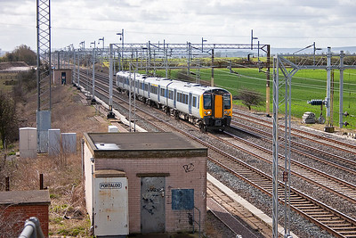 The full view looking south towards Ledburn Junction crossovers and Cheddington station in the distance. Also nearby is Bridego Bridge, the site of the Great Train Robbery on 8th August 1963. Desiro EMU 350103 is northbound working 1N55 1022 off Euston to Northampton.