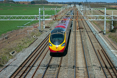 Looking down on the line looking north as an unidentified class 390 Pendolino unit heads for London from Wolverhampton, 1B42 1105 off.