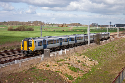 Desiro unit 350103 is seen again and glides south with no effort up the gentle 1 in 540 rising gradient. The working is 2N04 1132 Northampton to Euston.